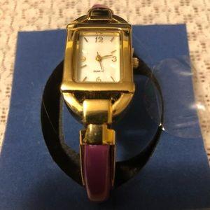 Violet vinyl band gold rectangular hinge watch.